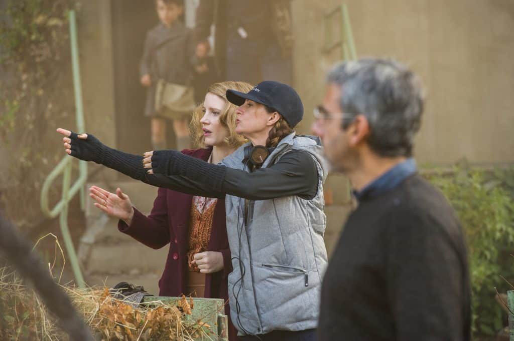 Jessica Chastain and director Niki Caro work out a scene on the set of THE ZOOKEEPER'S WIFE, a Focus Features release. Credit: Anne Marie Fox / Focus Features